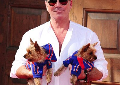 Simon Cowel with two yorkies