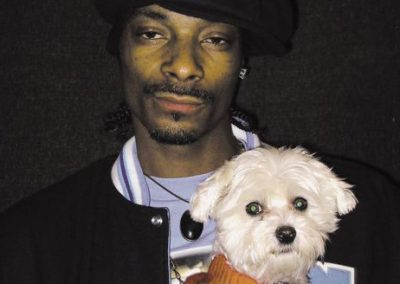 Snoop Dogg and his maltese dogs