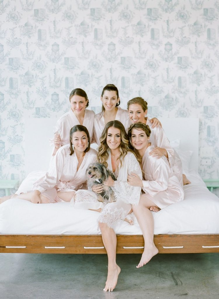 Bridesmaids on the bed photo, with dog