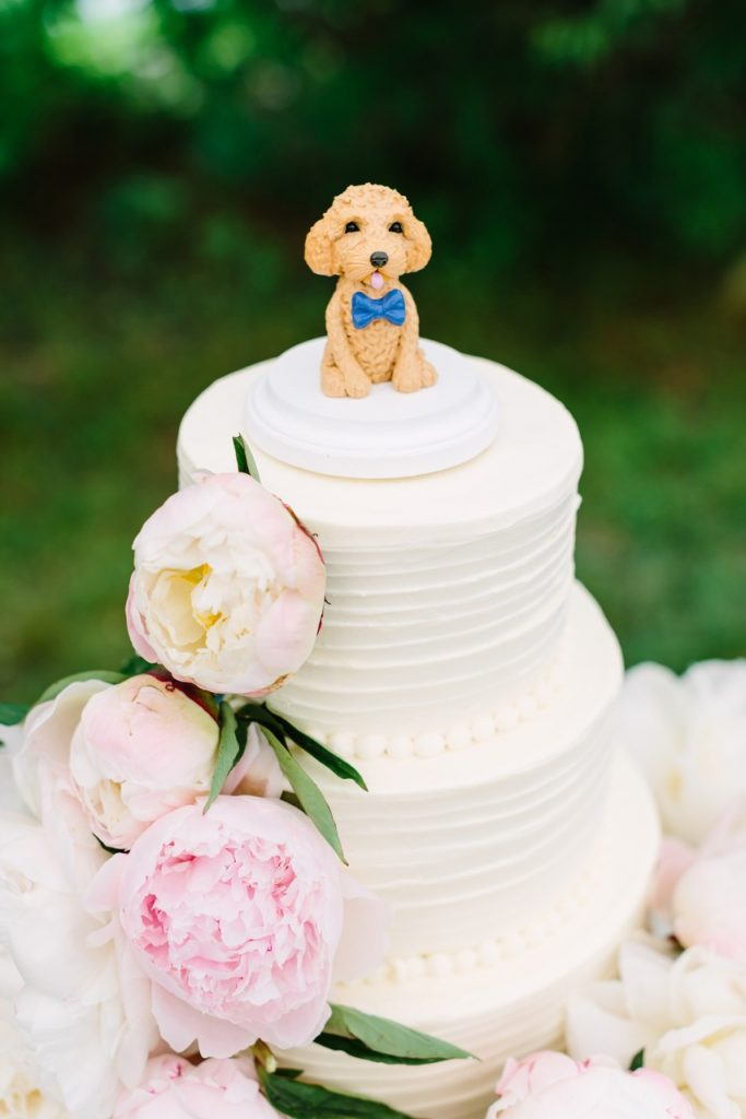 dog topper on wedding cake